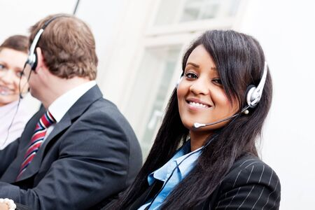 smiling callcenter agent with headset support hotline Stock Photo - 17290727