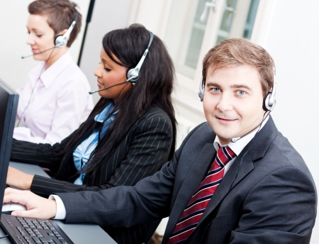 smiling callcenter agent with headset support hotline Stock Photo - 17290706