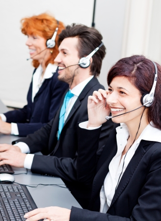 smiling callcenter agent with headset support hotline Stock Photo - 17290048