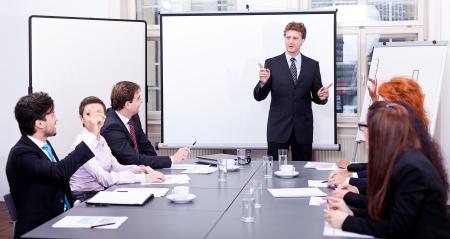 business team op tafel in het kantoor conference seminar presentatie Stockfoto