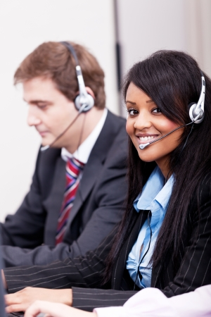 smiling callcenter agent with headset support hotline photo