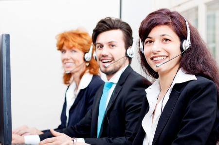 smiling callcenter agent with headset support hotline Stock Photo - 17290483