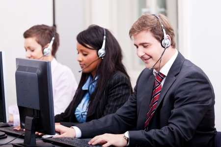 smiling callcenter agent with headset support hotline Stock Photo - 17290886