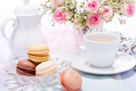 traditional delicious sweet dessert macarons and coffee on table Stock Photo