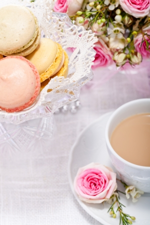 traditional delicious sweet dessert macarons and coffee on table photo