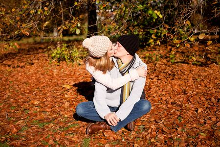 happy young couple smilin in colorful sunny autumn outdoor in park photo