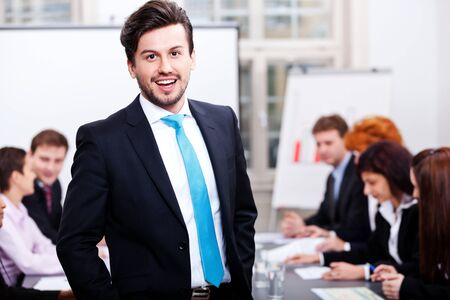 successful business smiling man portrait at office with team in background Stock Photo - 17449264