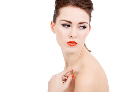 perfect beauty woman face with orange lips isolated on white background photo