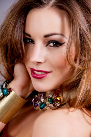 attractive brunette woman with glamour jewellry and make up portrait Stock Photo - 17837515