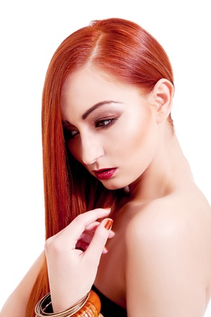 attractive young woman with shiny red hair and beauty makeup portrait photo