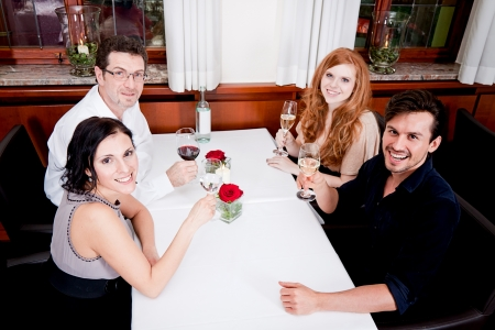 smiling happy people in restaurant drinking talking having fun  photo