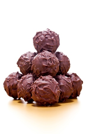 collection of different chocolate pralines truffels on golden brown background macro Banque d'images