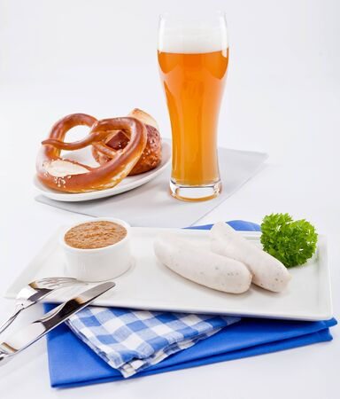 weisswurst: weisswurst white sausages and sweet mustard with pretzel  bavarian traditional food Stock Photo