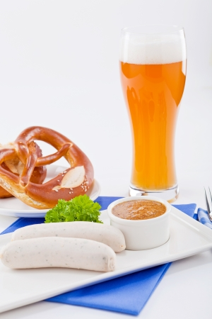 weisswurst white sausages and sweet mustard with pretzel  bavarian traditional food photo