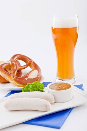 sweet mustard: weisswurst white sausages and sweet mustard with pretzel  bavarian traditional food Stock Photo