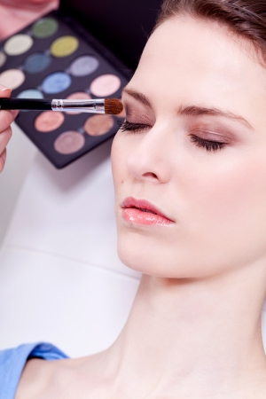 attractive woman in beauty salon make up brown eyeshadow professional