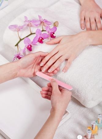 professional manicurist doing a manicure natural look