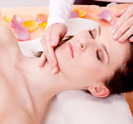 young attractive smilig woman doing wellness spa relaxing massage photo