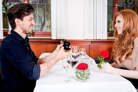 happy couple in restaurant romantic date love dinner valentines day wedding photo