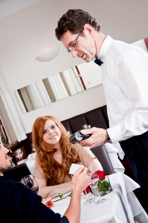 pay desk: happy couple in restaurant pay cash free  by credit card electronic security money