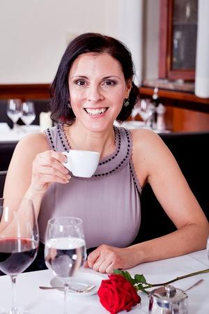 waiter serve fresh espresso for happy couple in restaurant photo