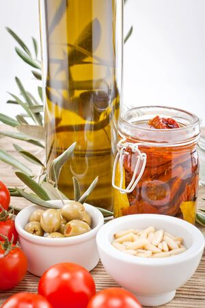 Tasty green olives, tomatoes and olive oil ingredients vegetarian food photo