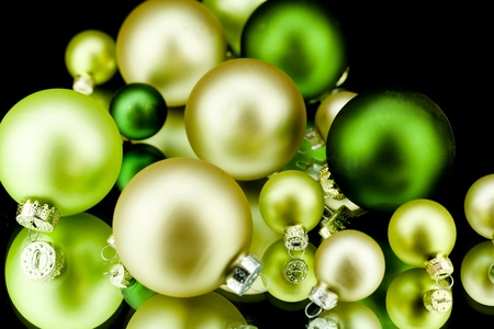 christmas decoration in gold lime green and champagner on black background photo