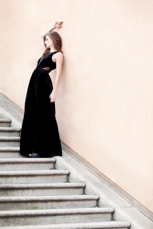 beautiful woman in long black evening dress outdoor fashion photo