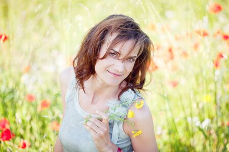 adult brunette woman smiling in summertime outdoor nature photo