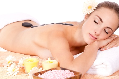 young attractive woman hot stone massage wellness isolated on white
