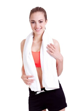 young attractive woman with towel sports outfit isolated on white background photo