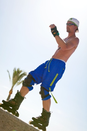 rollerskater: young man with inline skates in summer outdoor rollerblades skater Stock Photo