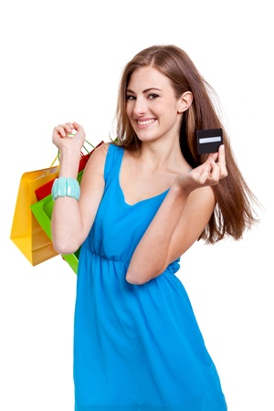 happy young woman with colorful shopping bags visa credit card isolated photo