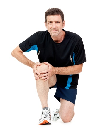 knee cap: adult attractive man in sportswear knee pain injury ache isolated on white Stock Photo