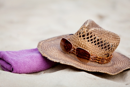 sunprotection objects on the beach in holiday sunglasses hat suncare photo