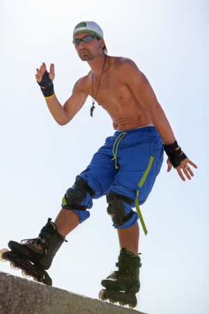 young man with inline skates in summer outdoor rollerblades skater photo