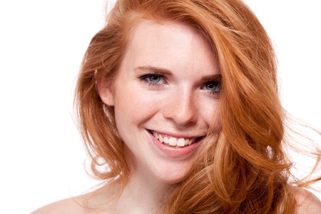 beautiful young smiling woman with red hair and freckles isolated on white portrait photo