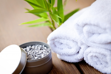 wellness and spa beauty treatment objects on wooden background bamboo aroma therapy