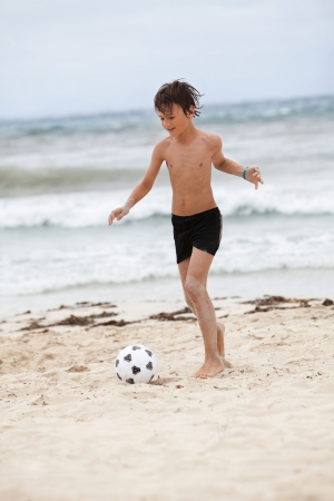 happy family father two kids playing football on beach summer fun soccer Stock Photo - 21283857