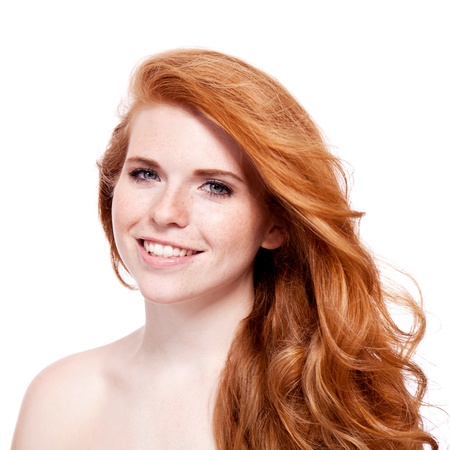 beautiful young redhead woman with freckles portrait isolated on white