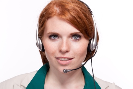 attractive smiling business woman callcenter agent operator isolated on white Stock Photo - 21284221