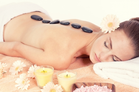 attractive helathy caucasian woman hot stone massage wellness  spa therapy photo
