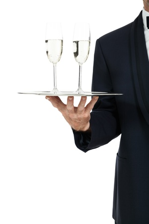 adult male waiter serving two glass of champagne isolated on white photo
