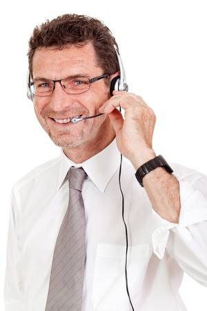 smiling mature male operator businessman with headset call senter helpdesk Stock Photo - 21357154