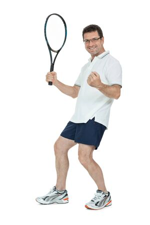 smiling adult tennis player with racket in sportswear  isolated on white photo