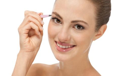 tweezing: beautiful young woman and eyebrow tweezers isolated on white Stock Photo