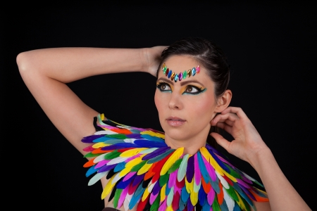 beautiful woman with colorful extreme makeup and accessoires portrait  photo