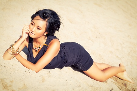 beautiful asian woman with colorful makeup on the beach portrait summer beauty photo