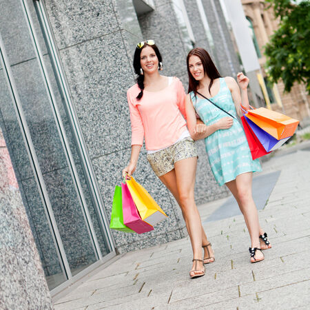 attractive young girls women on shopping tour outdoor city summer  photo