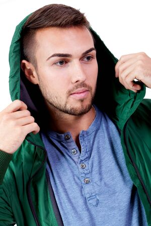 young adult man with green jacket portrait isolated on white photo